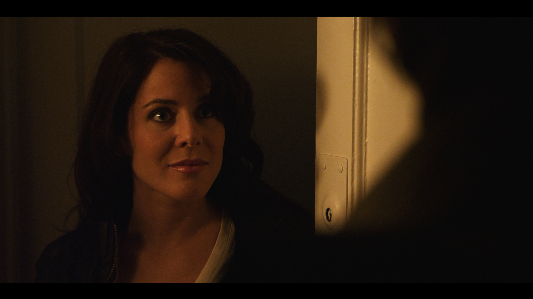 Sailor Stewart (Rebecca Mae Palmer) at the apartment. Still from the film.