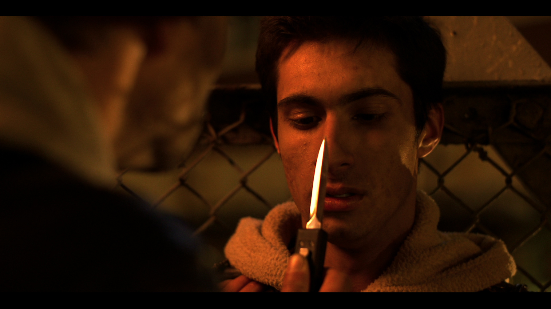 Knife in Jack's (Zuher Khan) face. Still from the film.