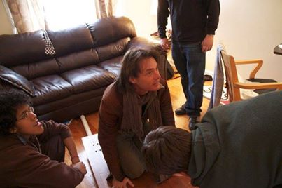 Actor James Wilder getting notes from Director  Hilarion Banks  (not pictures) before shooting the next take.