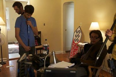 """Actors Zuher Khan (left) and James Wilder (right) prepping and going over lines before shooting the next scene in """"Jack's apartment""""."""