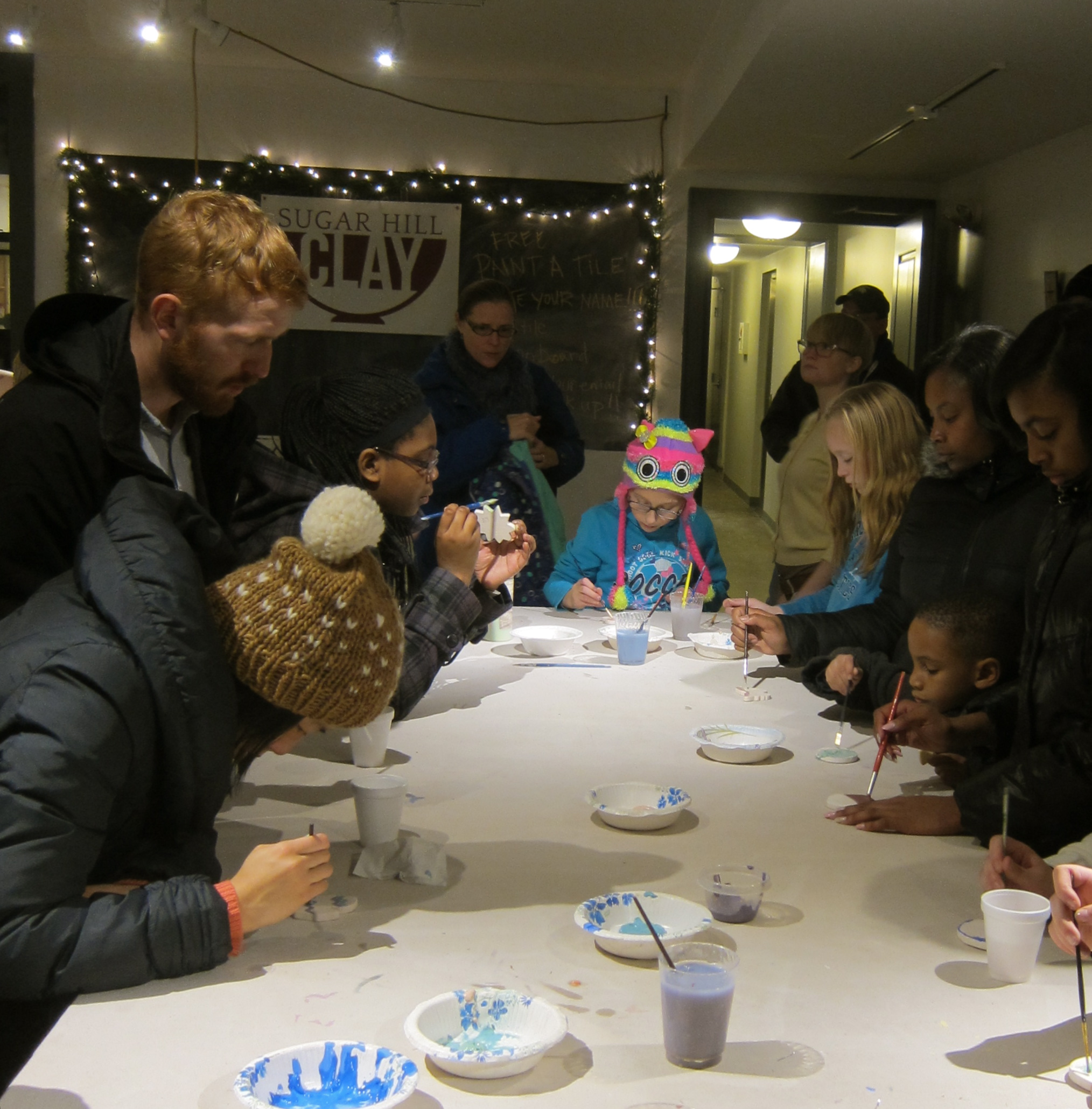 Painting tiles at Noel Night 2014