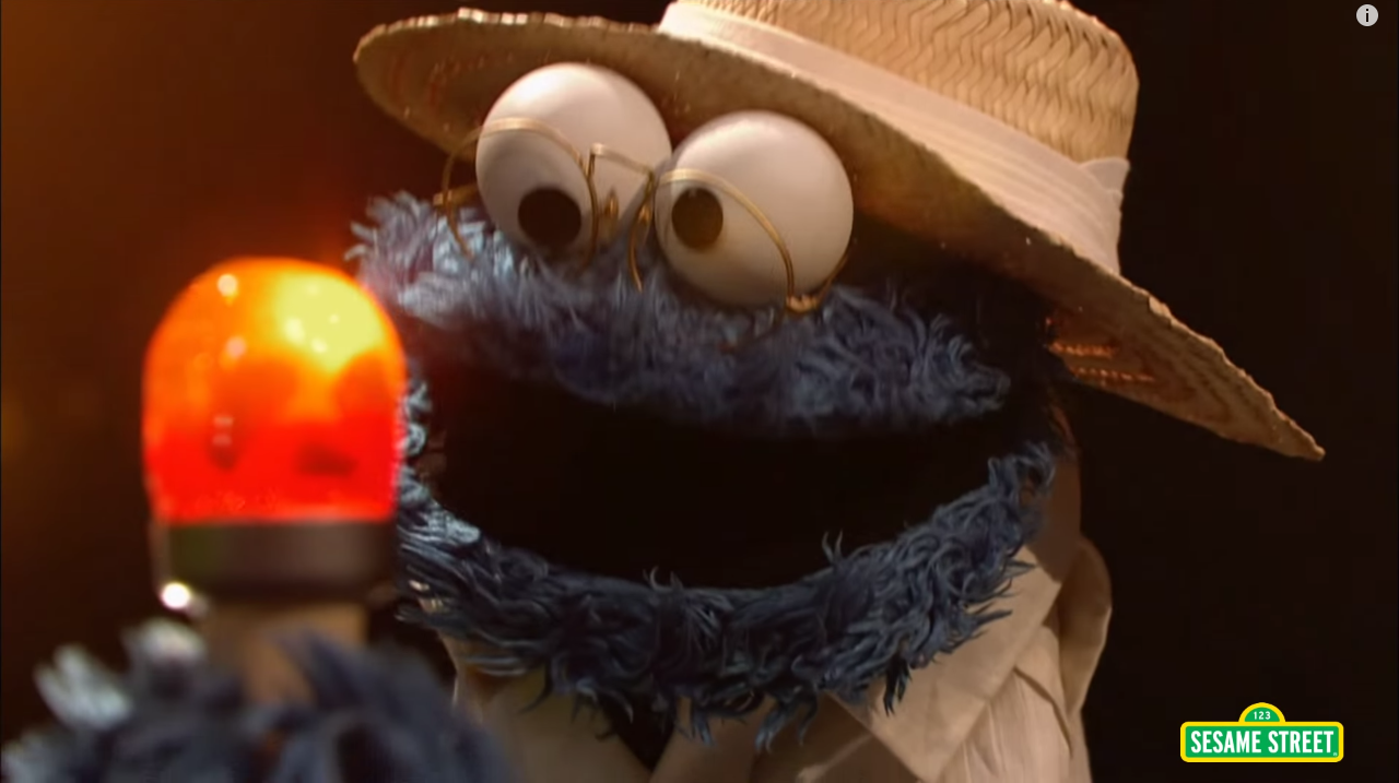 sesame-streets-charming-jurassic-park-spoof-with-cookie-monster-as-john-hammond