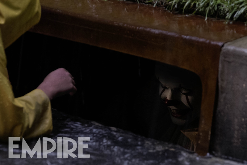 new-image-from-stephen-kings-it-features-pennywise-about-to-tear-georgies-arm-off