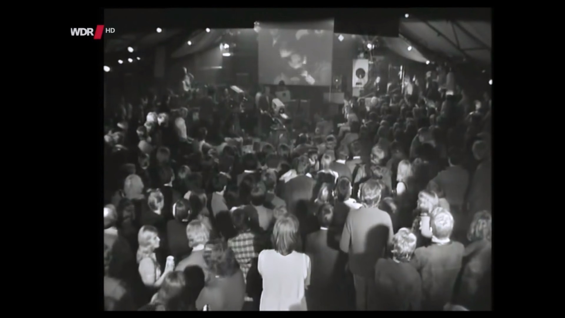 watch-kraftwerk-the-fathers-of-electronic-music-play-to-a-confused-crowd-in-1970-social.jpg