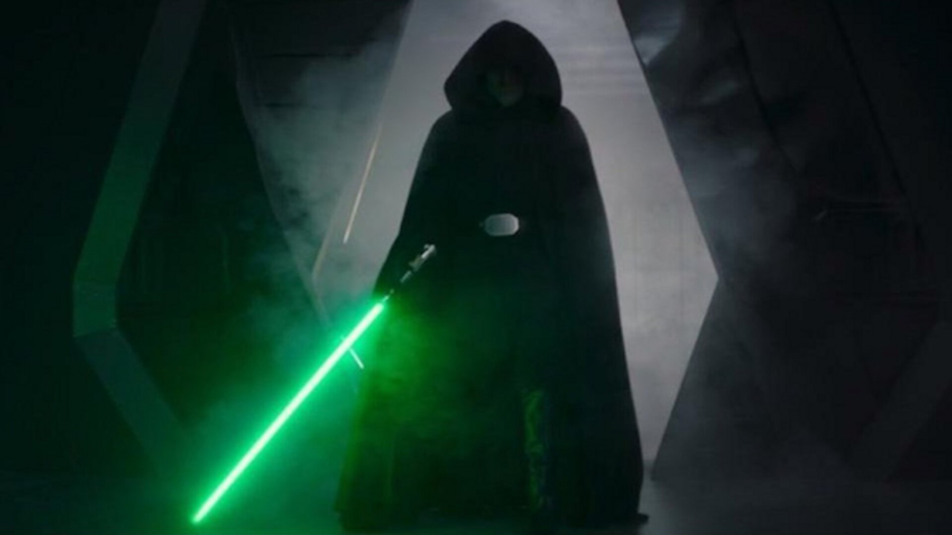 Who could that black-hooded guy be with the green lightsaber?