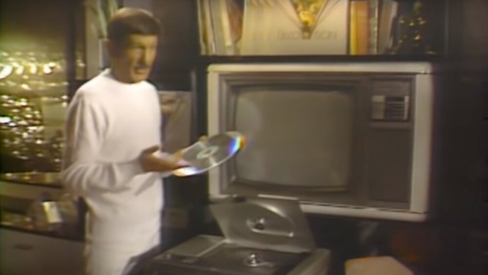leonard-nimoy-is-introduced-to-the-mangnavision-laserdisc-player-by-a-rock-in-1981-video.jpg