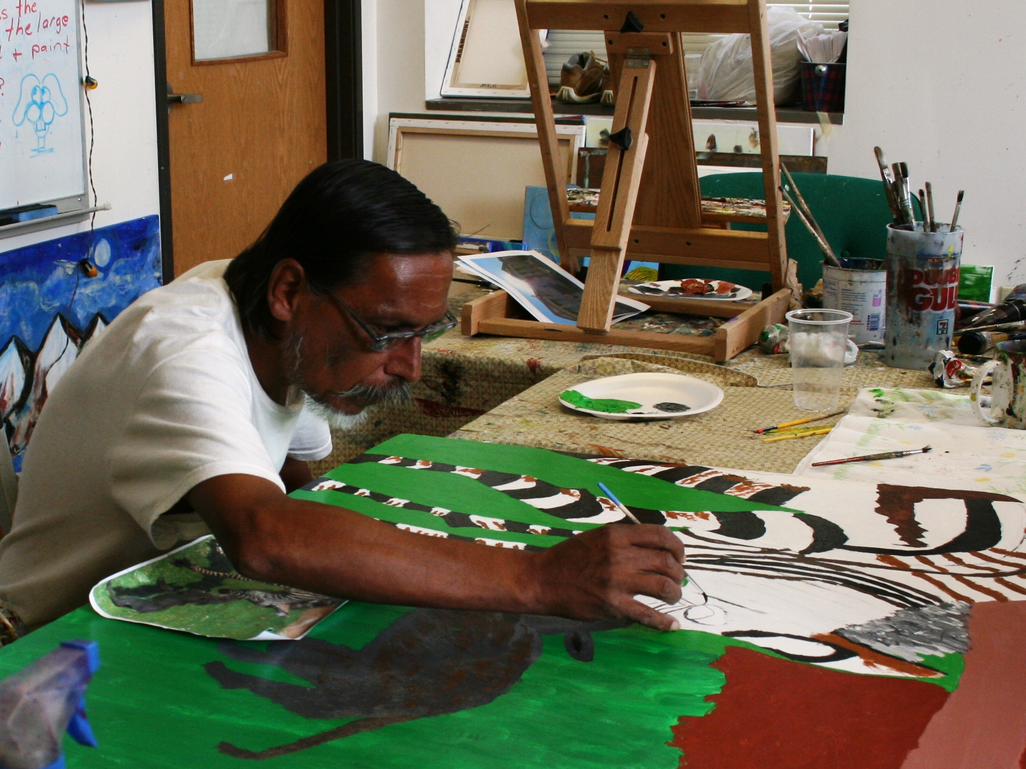 Luis Arispe at work in the Open Art Studio.