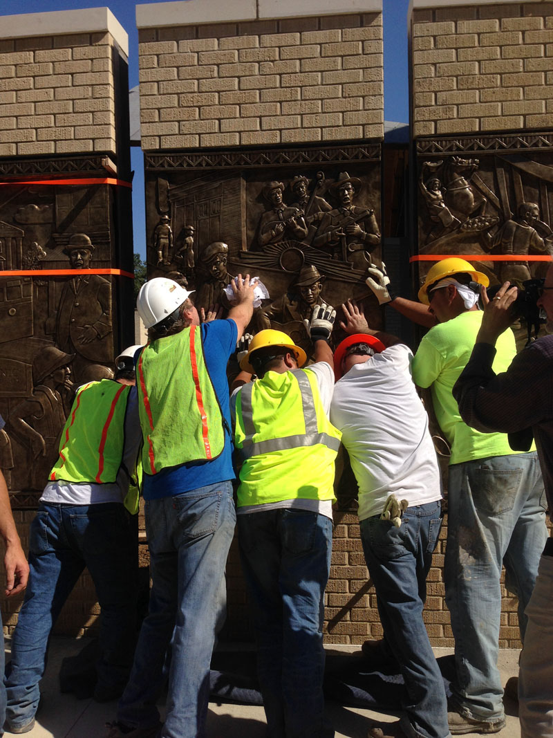 Placing the last panel into the sculpture wall.  This panel celebrates artists who recorded at 508, including Robert Johnson, Bob Wills, and The Light Crust Doughboys.
