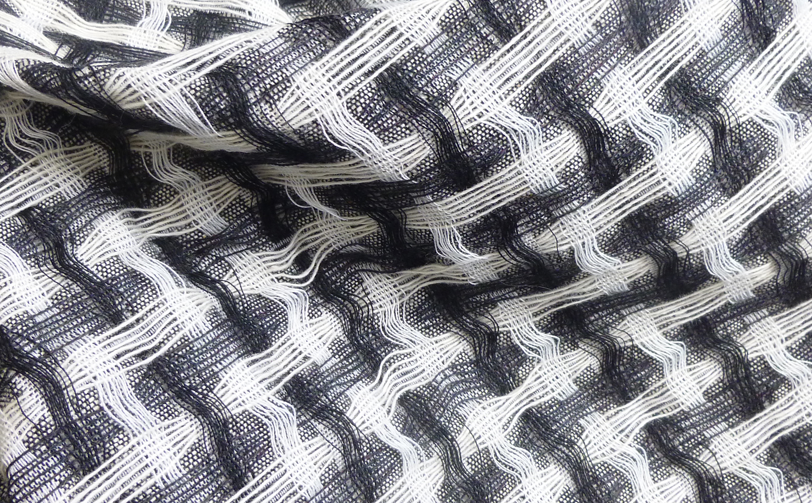Jacquard woven interlaced fabric. Cashmere and wool