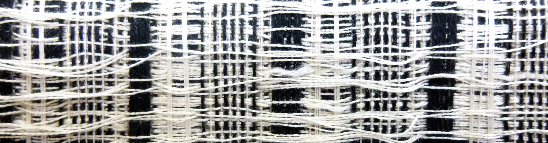Dobby woven silk, wool and cashmere exploiting loose weave structures on a sound structural  base