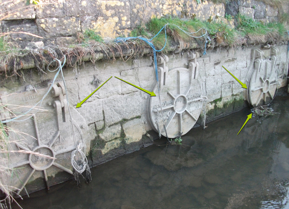 Residents have attached ropes to these flap valves for manual operation due to ongoing problems with blockages