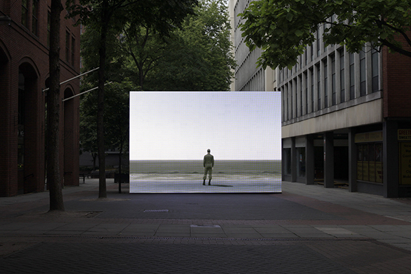 """Infinite Freedom Exercise (near Abadan, Iran)"", by Irish artist John Gerrard.  On an LED wall in Lincoln Square in    Manchester, the work portrayed a contemporary Iranian landscape remade as a    virtual world seen in real-time, 24 hours a day.  Manchester International Festival, 2013"