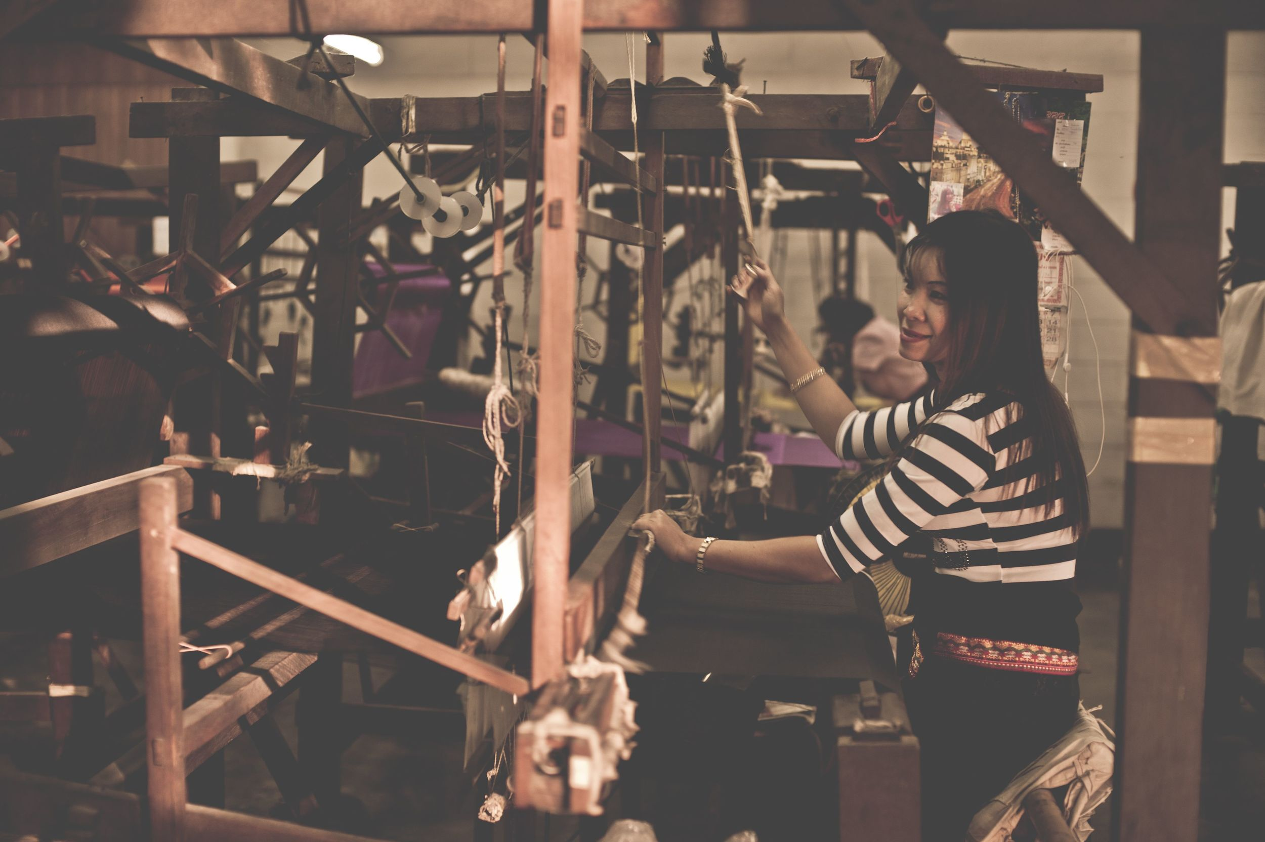 Nineteenth Century-style  looms in a traditional silk weaving factory, Chiang Mai