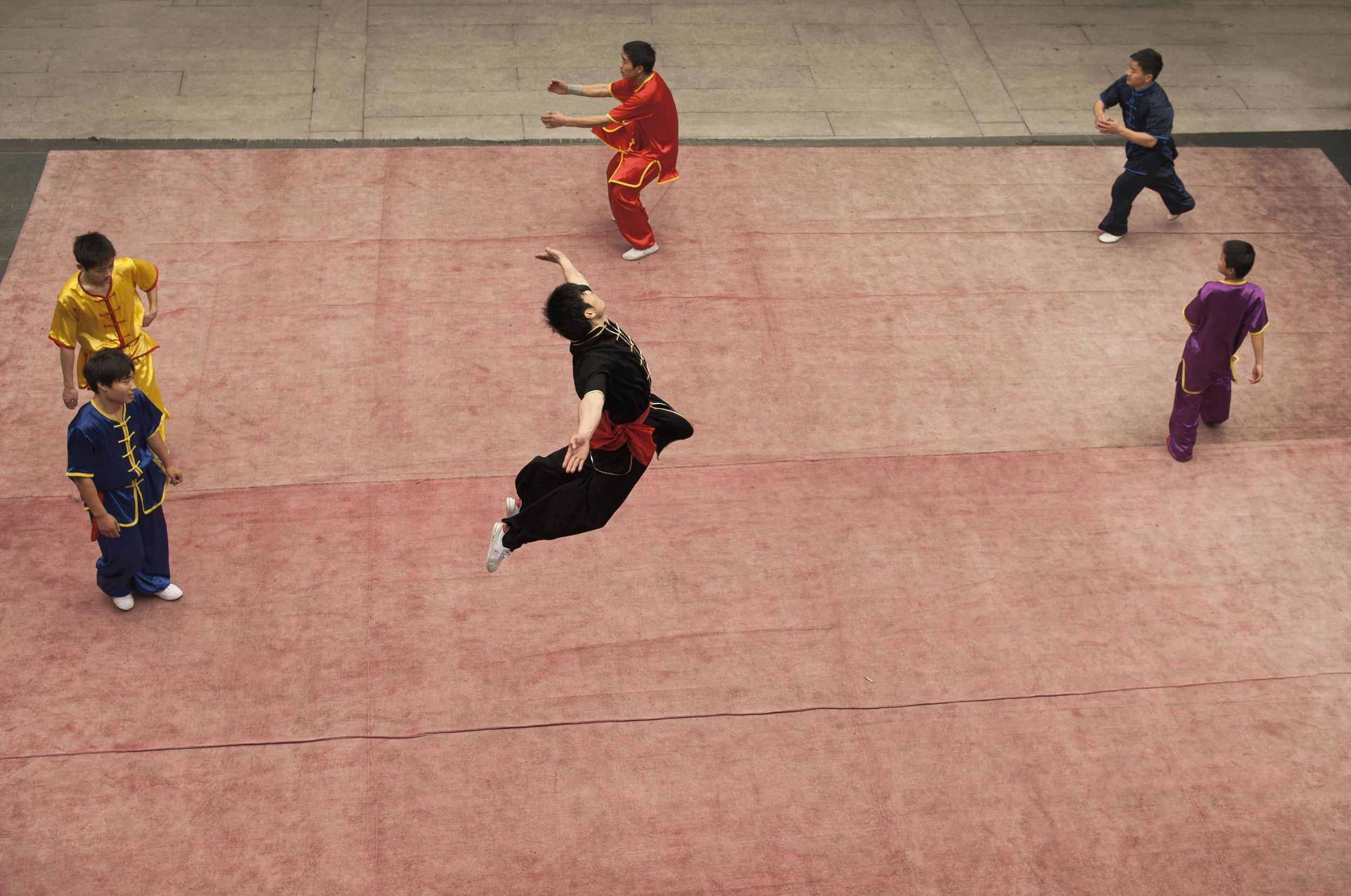 Boys training in hung ga get put through their paces in a warm up before their routine for visitors