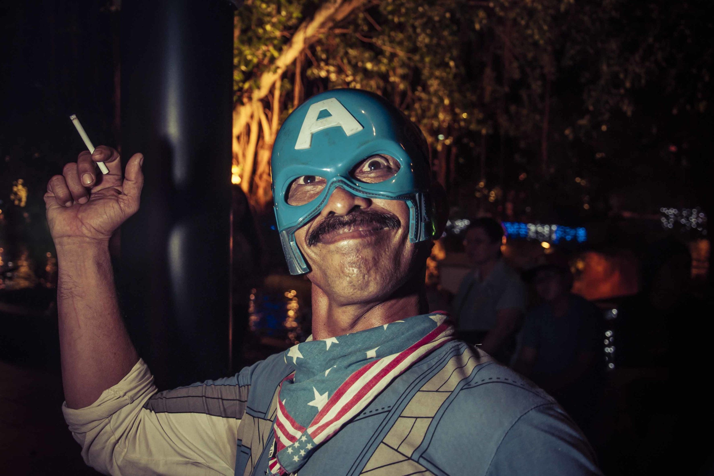 Captain America, a one man show stationed outside the Hard Rock Cafe, Malacca,  poses during his cigarette break.