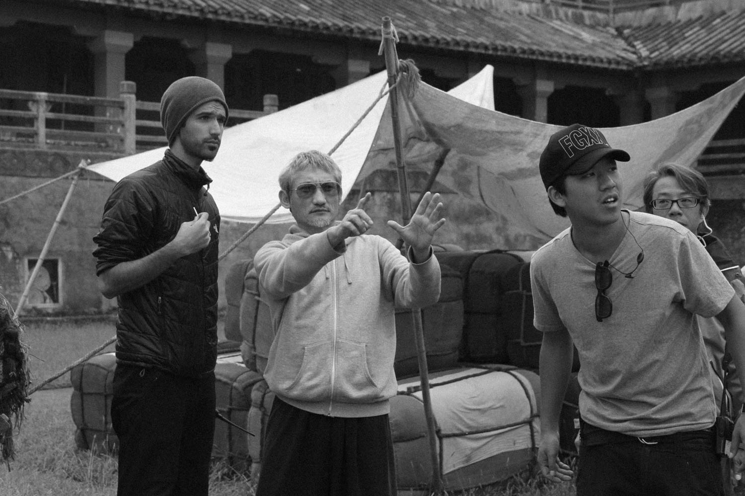Discussing a shot with director Tsui Hark on the set of Flying Swords of Dragon Gate.