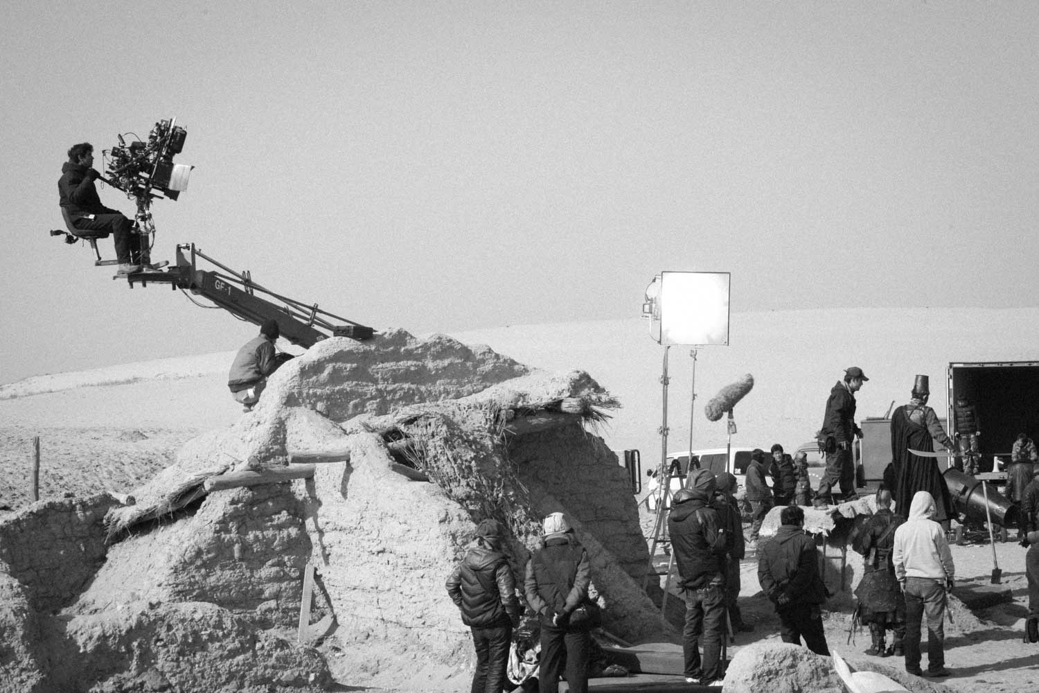 Operating a shot in the deserts of North East china on the set of  Flying Swords of Dragon Gate.