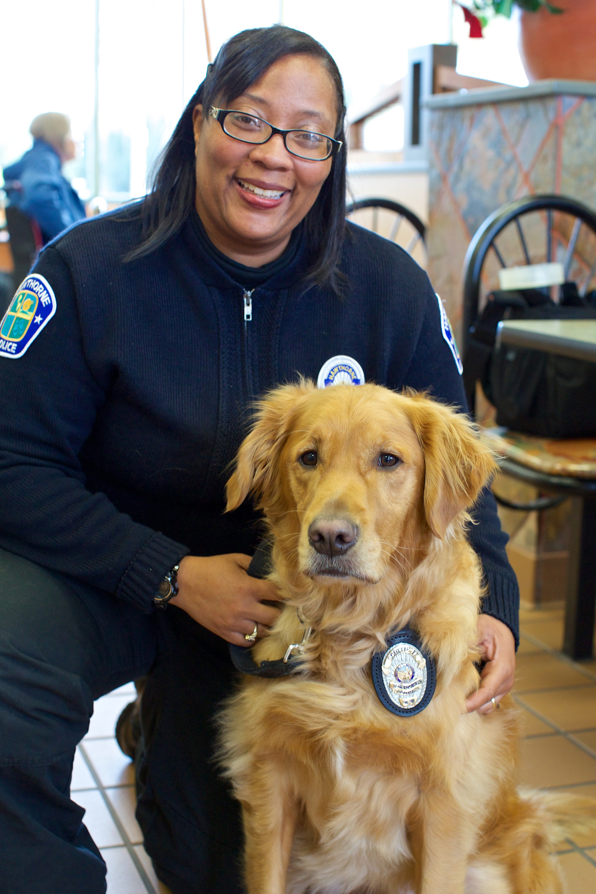 HPD Police Service Officer Bell and Scottie.  She takes care of Scottie 24/7.