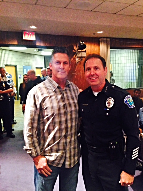 Chief Fager with Detective Johnson at the Council meeting for the proclamation