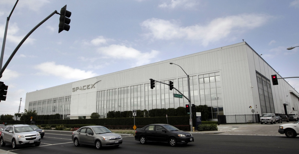 Motorists drive by SpaceX headquarters in Hawthorne, Calif. File photo. (AP Photo/Jae C. Hong)