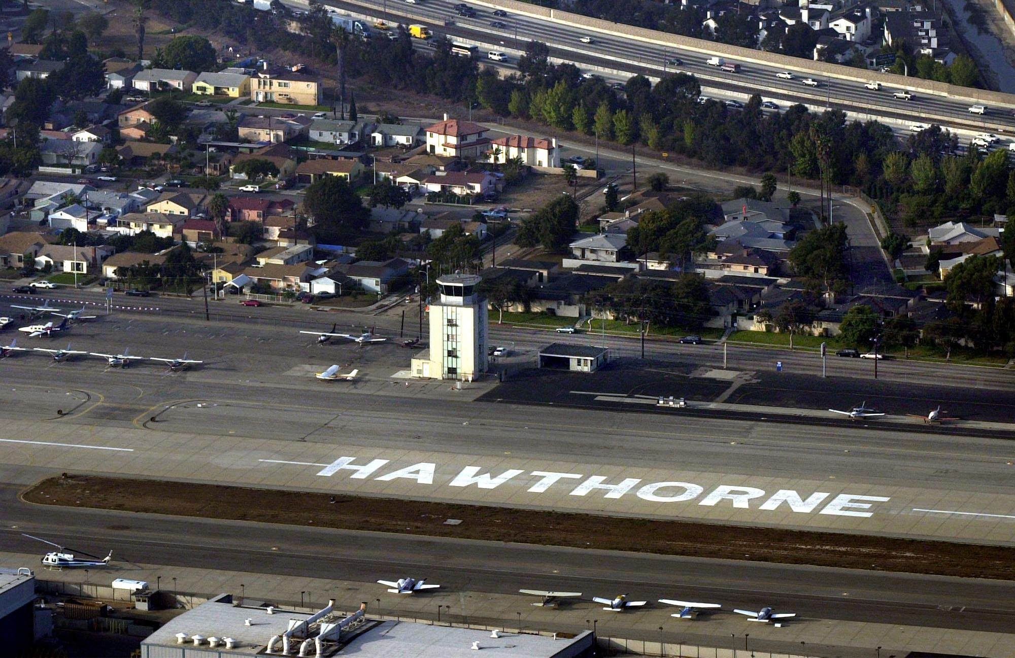 Hawthorne Municipal Airport, looking north with the Century Freeway at upper right. 2001 file photo. (Brad Graverson / Staff Photographer)