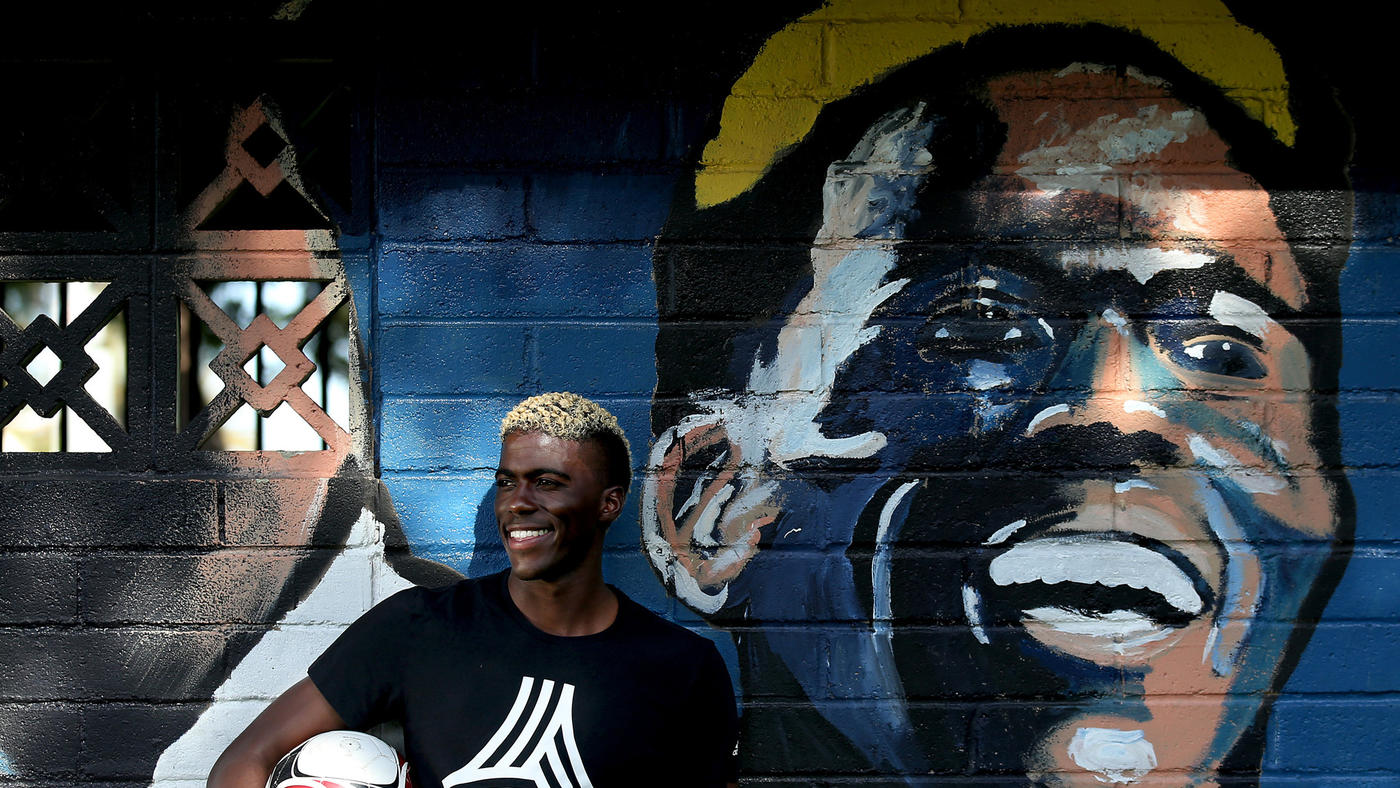 Luis Sinco / Los Angeles Times  Galaxy forward Gyasi Zardes stands next to a mural of himself at Hawthorne Memorial Park. He grew up in Hawthorne and played soccer at nearby Leuzinger High in Lawndale.
