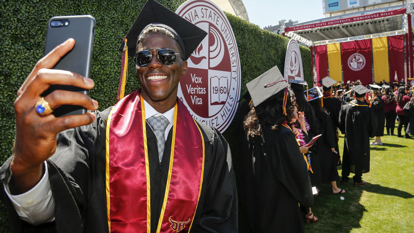 Mark Boster / Los Angeles Times  Gyasi Zardes snaps a selfie of himself while waiting with other graduates at Cal State Dominguez Hills' commencement ceremony at StubHub Center, where he stars for the L.A. Galaxy.