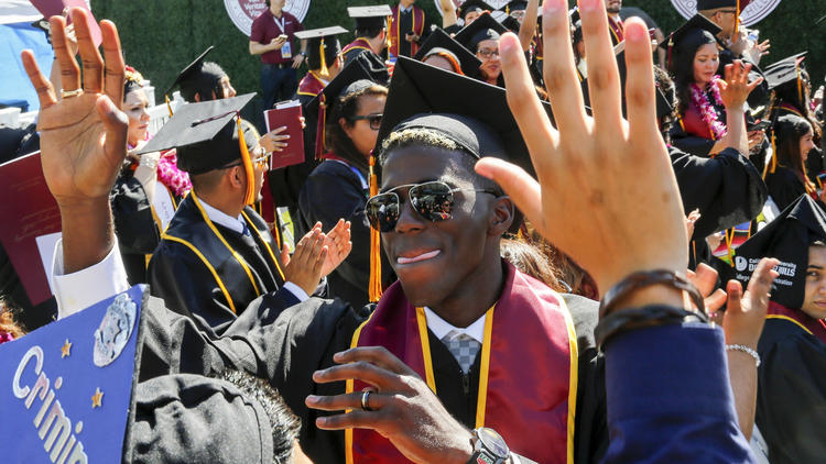Gyasi Zardes celebrates with fellow Cal State Dominguez Hills graduates during their graduation ceremony. (Mark Boster / Los Angeles Times)