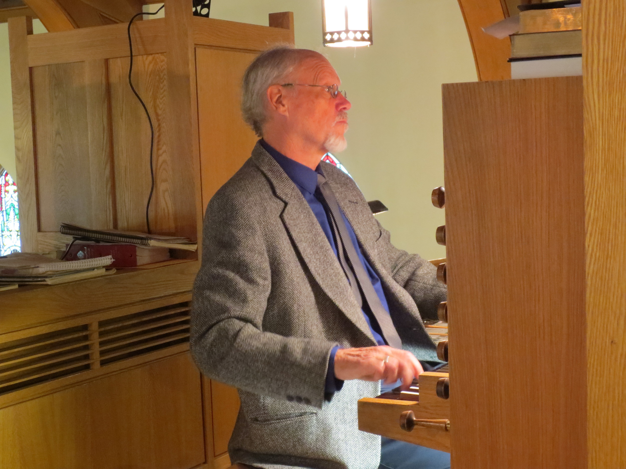 Bradley Moggach at the console of the Wolffe Opus VIII organ.
