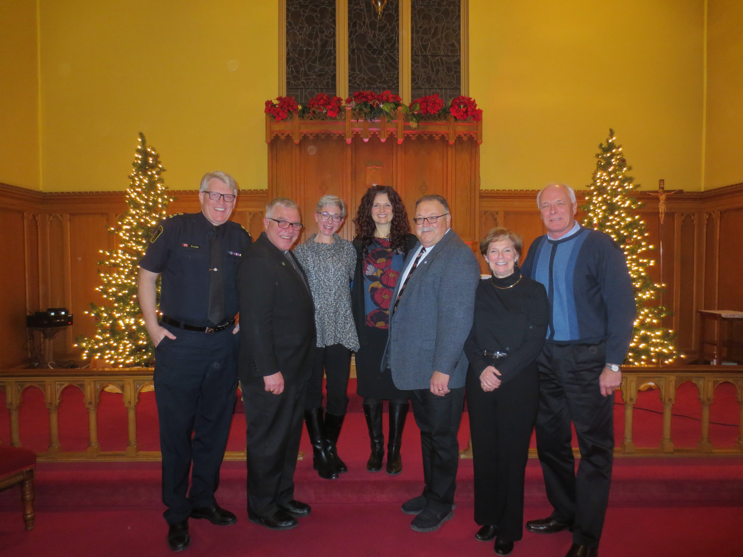 Our Annual Dramatic Reading of Charles Dickens' 'A Christmas Carol' took place Friday, December 7, 2018. Featured readers and Master of Ceremonies L to R. Chief Bryan Larkin, Bishop Michael J. Pryse, Kimberly Strassburger, Eugenia Schatz, Karl Kiefer (past MC), Hon. Karen Redman, and Councillor Mike Mann.