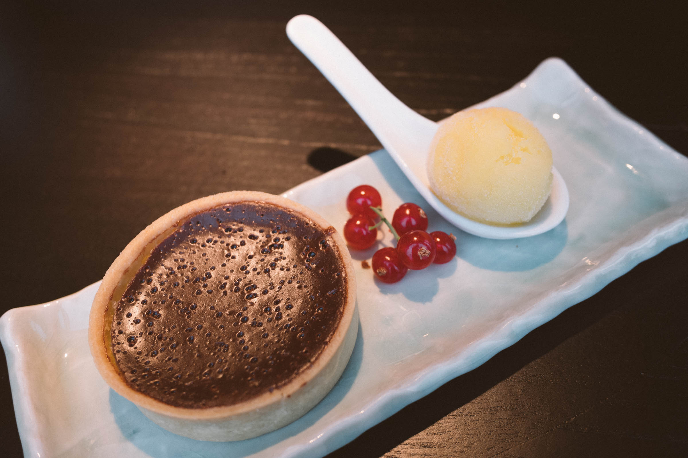 Chocolate tart with mandarin ice cream