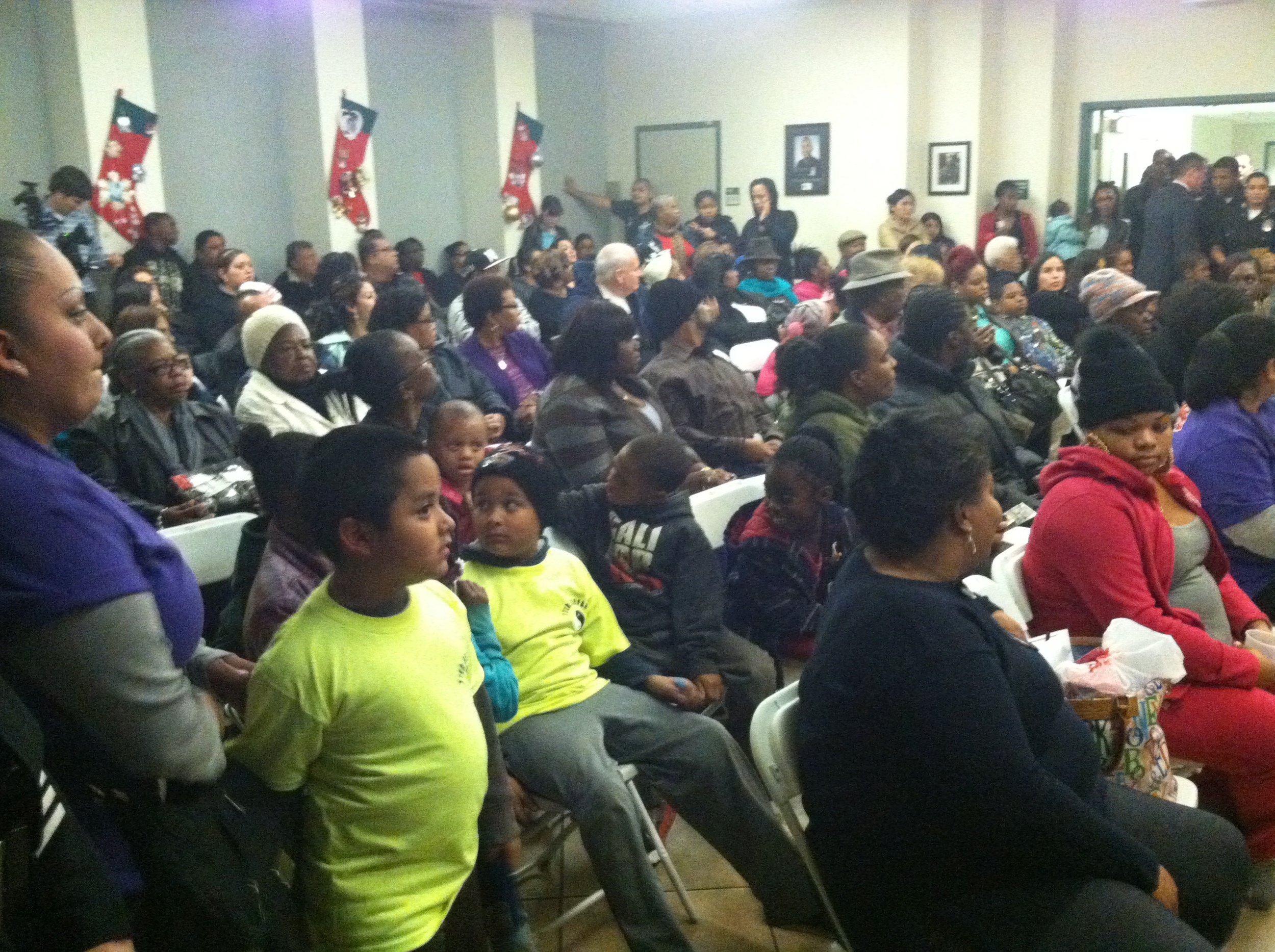 Family and friends of murder victims at LAPD's 77th Street Division of SouthBureau