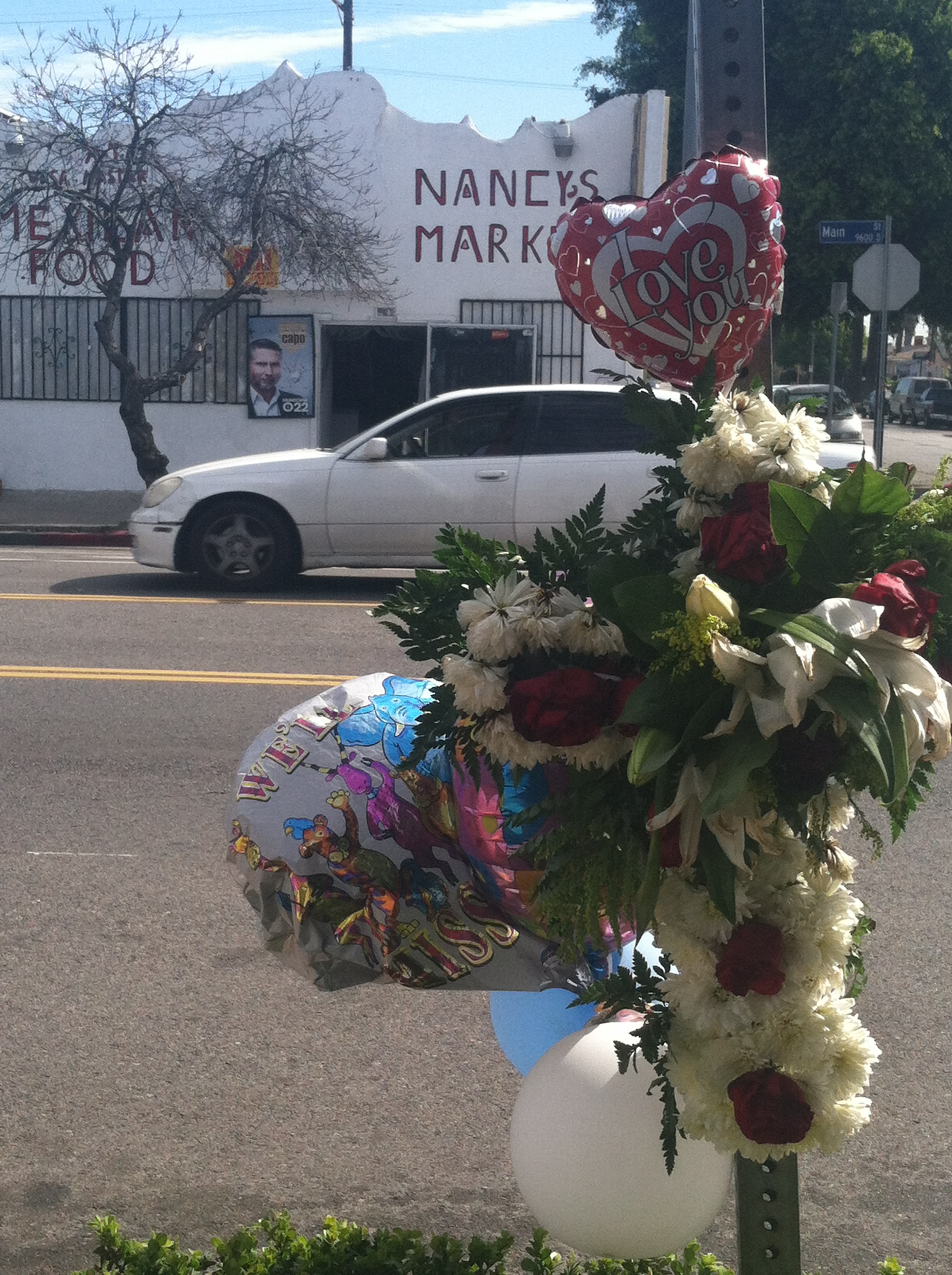 Street memorial for Douglas Wooley who was shot to death on March 6 at 97th and Main Street. Wooley, a sickle-cell anemia sufferer, was listening to music with earphones when he was gunned to the ground.