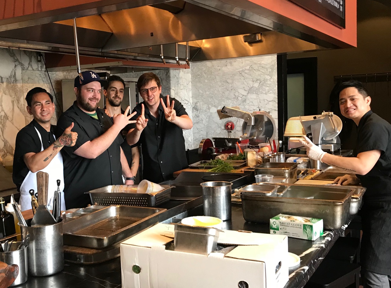 Chi Spacca chefs and cooks celebrate the 313.