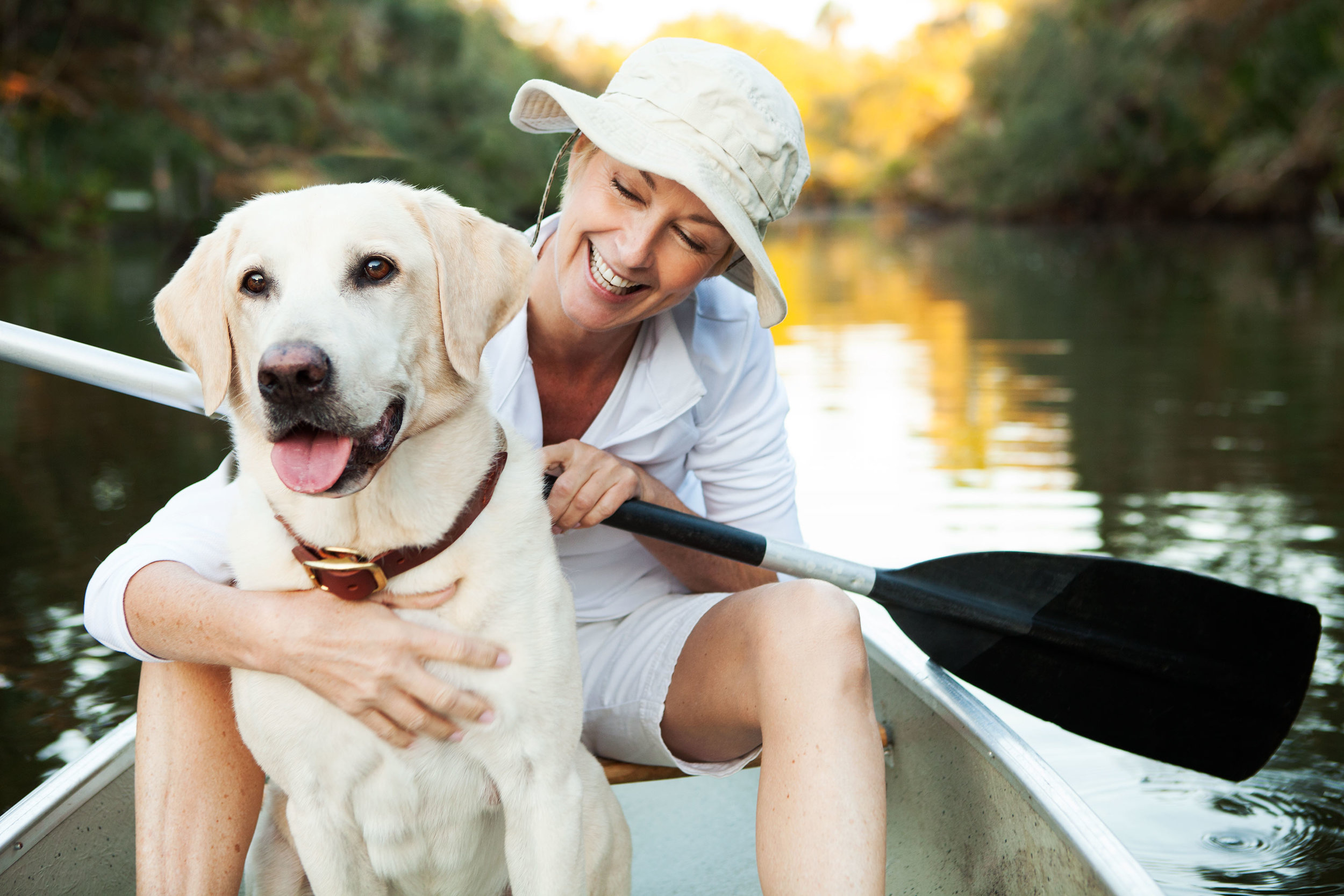 lifestyle_florida_verandah_woman_in_canoe_with_dogIMG_8922retouched_final_a_websize.jpg