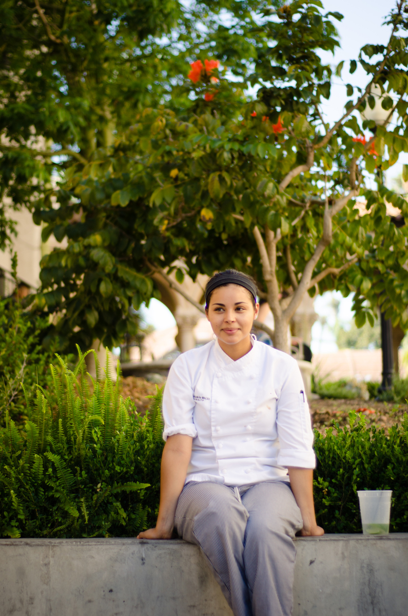 Gema, part of the cooking staff at The Prado, takes a break before heading back to work the first of three weddings scheduled on a typical Saturday for the restaurant. San Diego, 2013