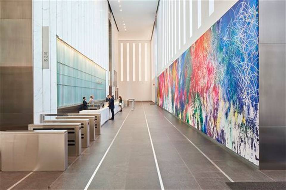 "This Nov. 2014 photo provided by Edelman Arts shows a color-splashed, 90-by-15-foot painting by the Miami-born Cuban artist Jose Parla in the vast lobby of the new 1 World Trade Center building in New York. The 104-story tower opened to great fanfare last month where Parla's ""ONE: Union of the Senses"" is the largest of the 13 public artworks by five artists selected or commissioned for the historic skyscraper. (AP Photo/Edelman Arts, Michael Mundy)"