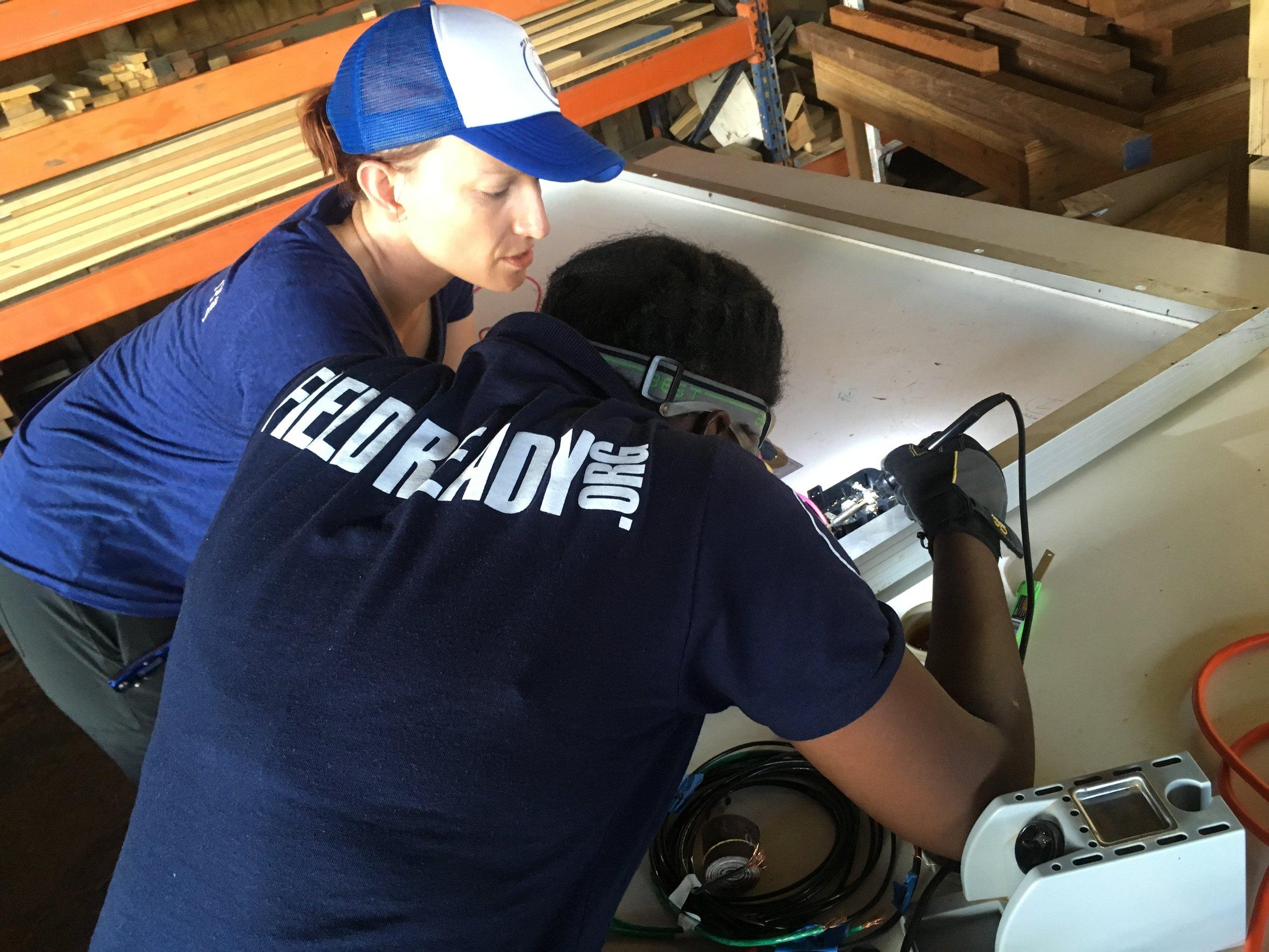 Dara and Julia working on panels.JPG