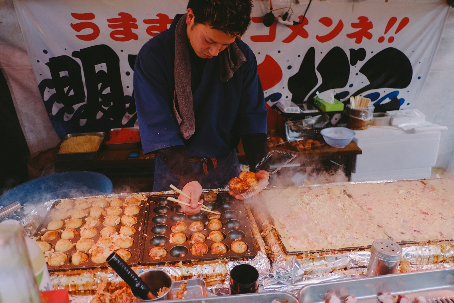 Takoyaki. Mesmerising to watch and smell. But we can't say we actually enjoy it.