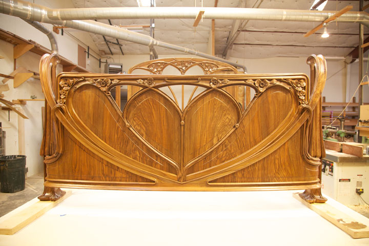 The footboard was redesigned with pierced tracery so the client could view his fireplace.