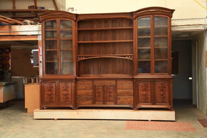Antique glass and custom designed antique reproduction pulls.
