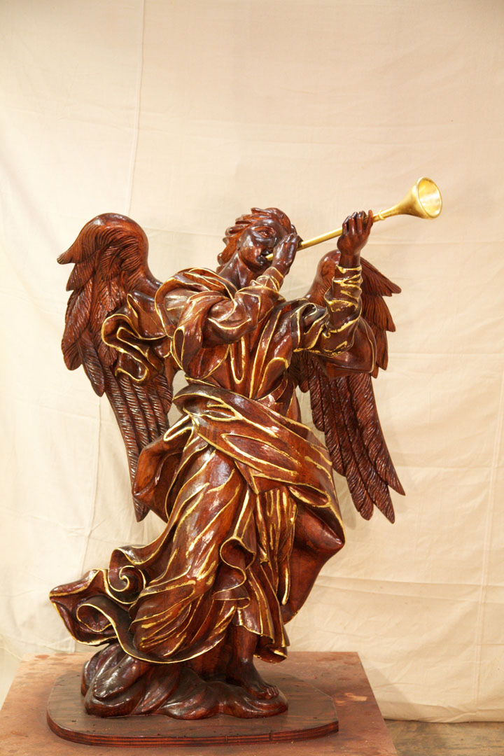 Hand carved angel with trumpet.