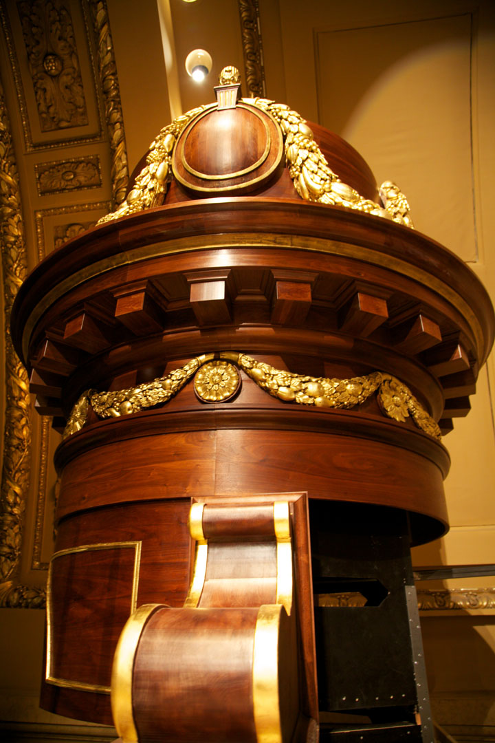 Detail of tower spire with gilded hand carved walnut adornments.