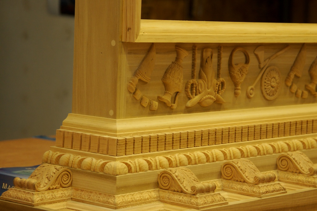 Neo-Classical fireplace details.