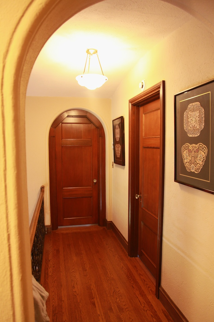 Refinished redwood doors in an historic Julia Morgan home.