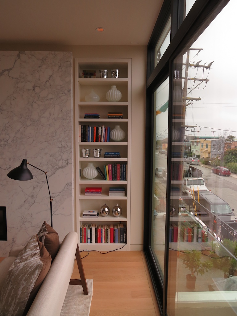 Built-in book case with adjustable shelves. AWL Grip finish.