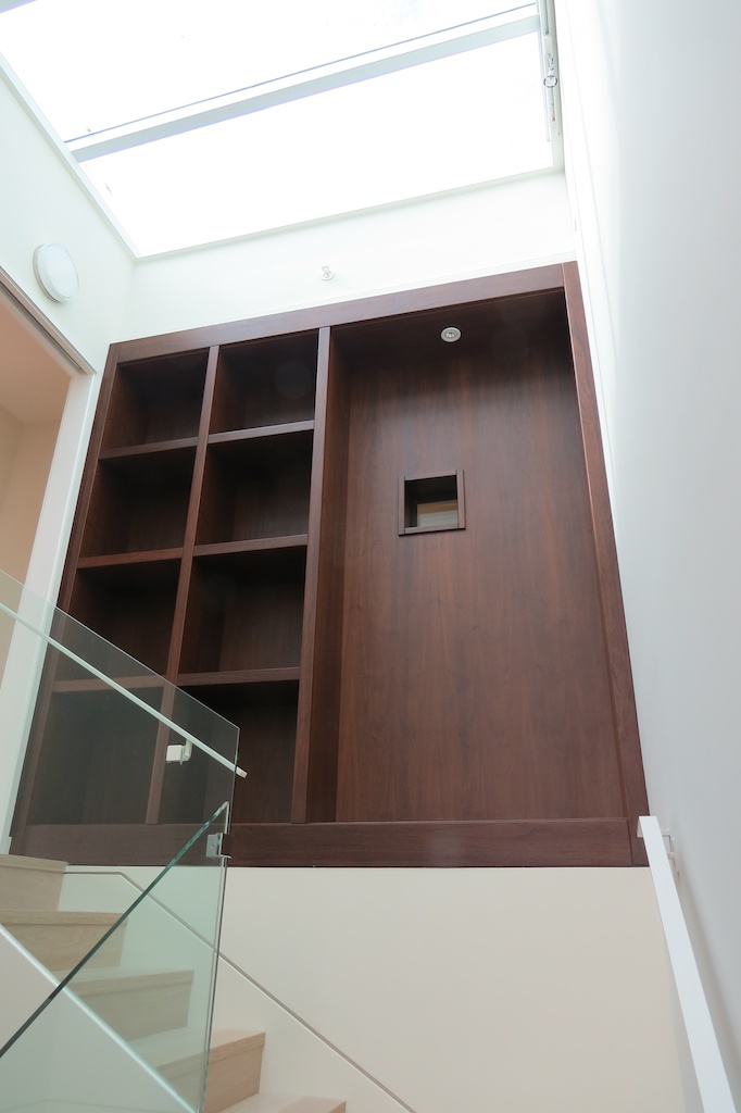 Stairwell cabinet with pressed Walnut veneers.
