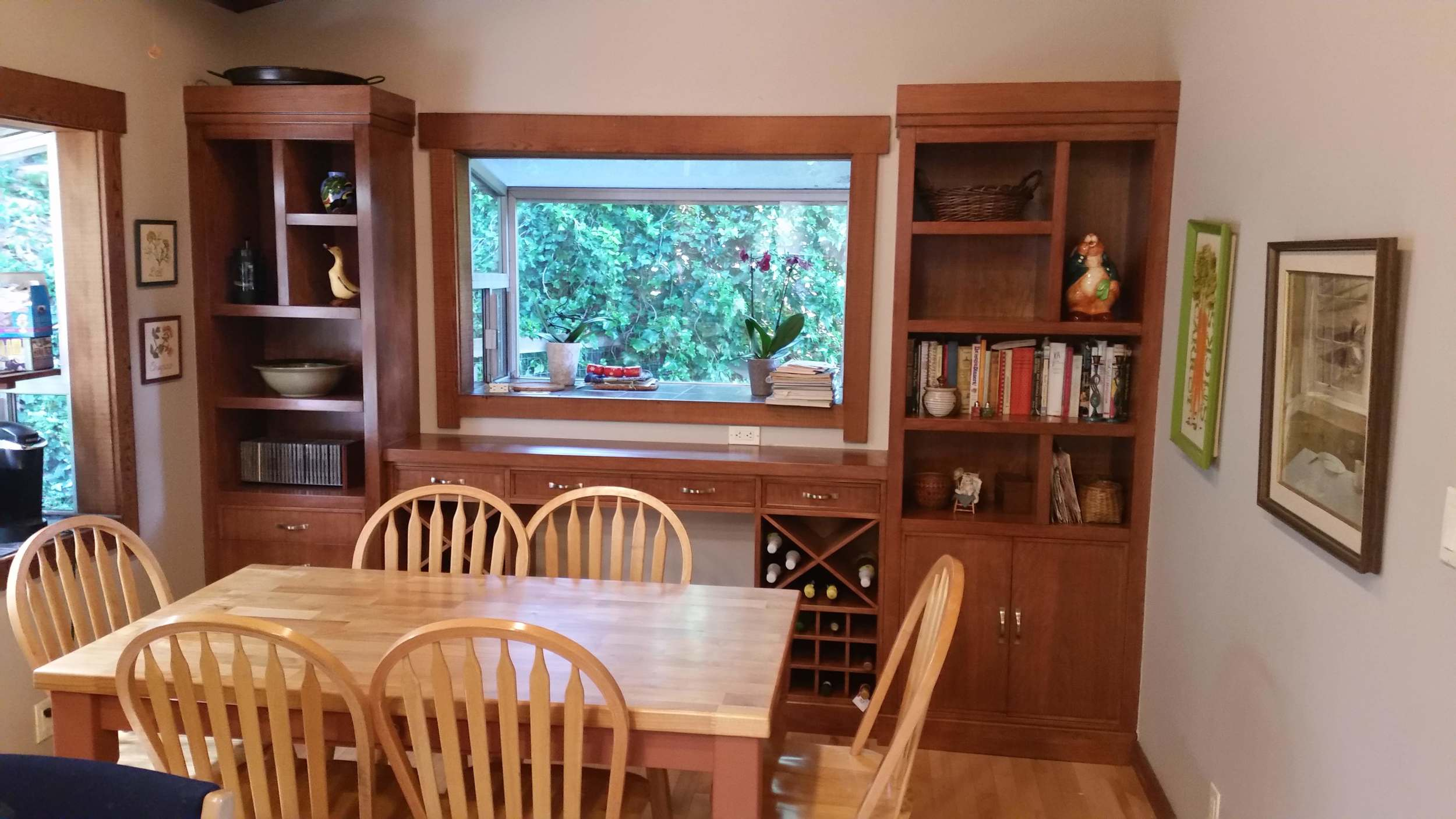 Completed cabinets in Cherry. The kitchen table was also refinished by Geoff's Woodworking.