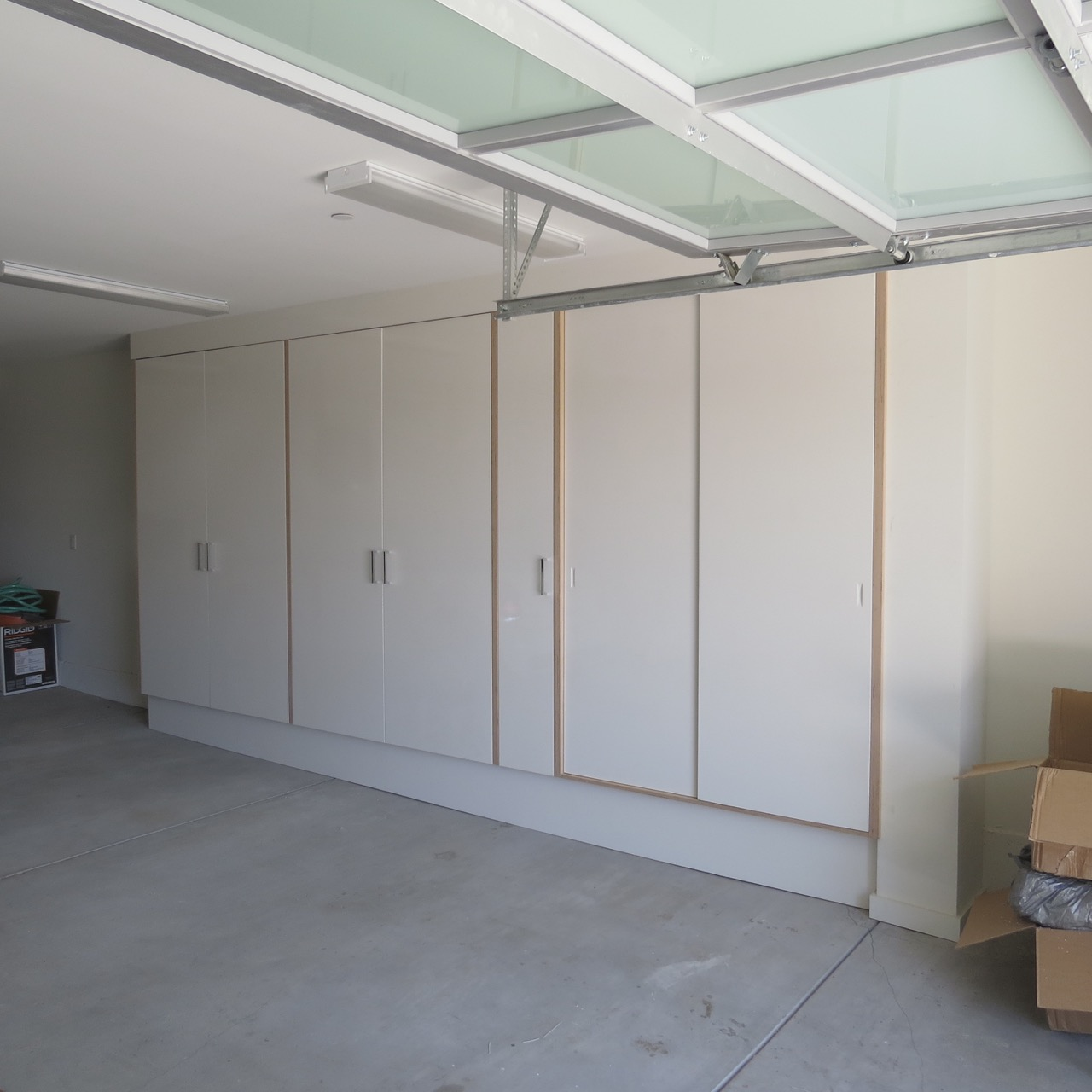 Completed garage unit with leaf and sliding doors.