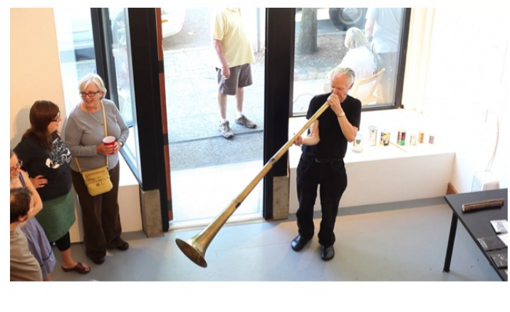 """TOPIC:  Authorship,     a series about ownership in creativity, from working collaboratively to repurposing material and interpreting the work of others. Here, musician Stuart Dempster plays on a home-made horn (and other found objects not pictured here) in an program he titled, """"Accidents of Manufacture."""""""